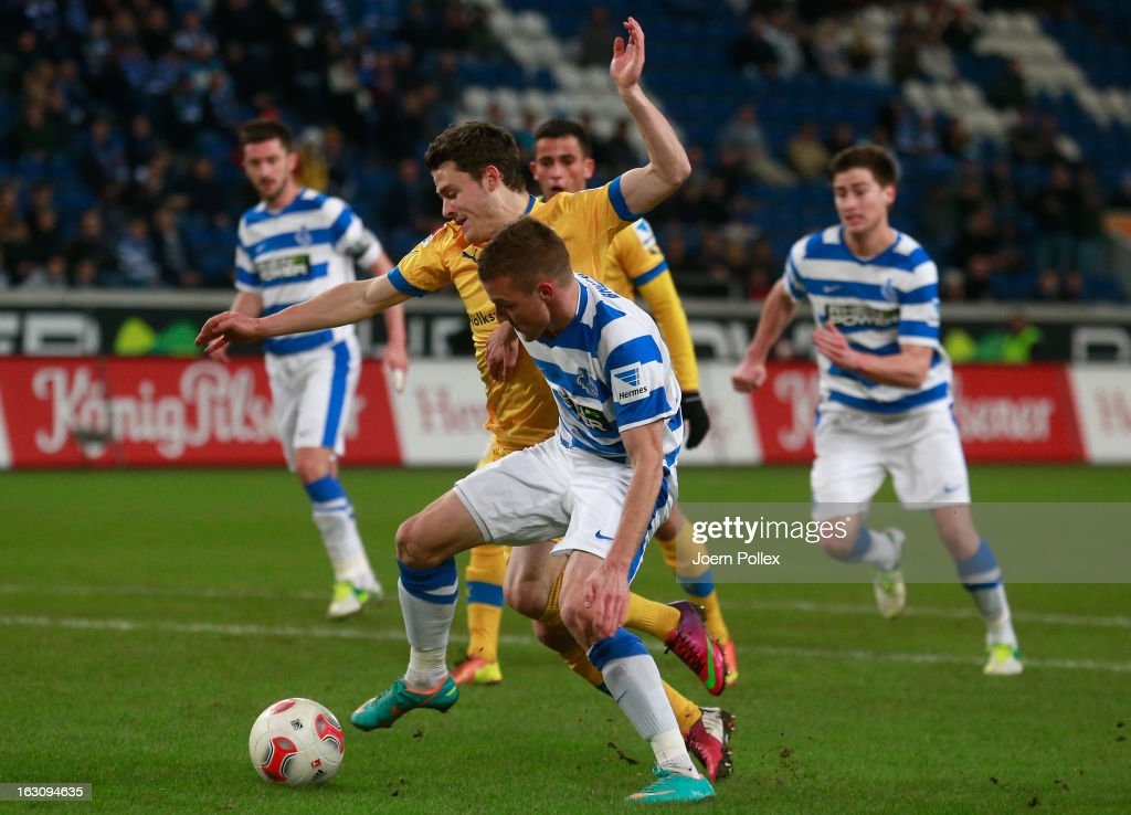 Ranisav Jovanovic (R) of Duisburg and Oliver Petersch of Braunschweig compete for the ball during the Second Bundesliga match between MSV Duisburg and Eintracht Braunschweig at Schauinsland-Reisen-Arena on March 4, 2013 in Duisburg, Germany.