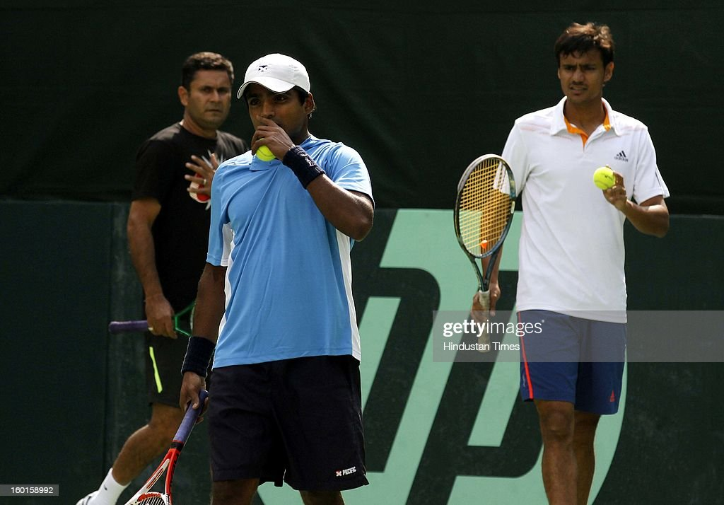 V M Ranjeeth and Vijayant Malik members of India Davis cup team practice for the upcoming Davis Cup match as coach Zeeshan Ali looks on during practice session at Delhi Lawn Tennis Association on January 27, 2013 in New Delhi, India.