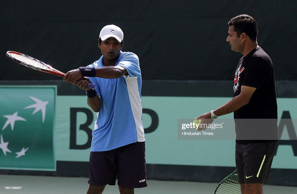 V M Ranjeeth member of India Davis cup team takes tips from coach Zeeshan Ali looks on during practice session at Delhi Lawn Tennis Association on January 27, 2013 in New Delhi, India.