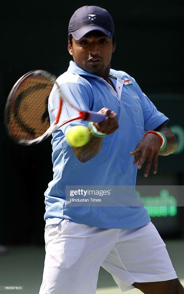 VM Ranjeeth of India during Davis cup reverse single match against Jeong Suk Young of Korea at Delhi Lawn Tennis Association stadium on February 3, 2013 in New Delhi, India.