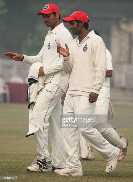 Ranji Players Pradeep Sangwan and Parvinder Awana on the third day of the Ranji Trophy Super League Group B Match between Maharashtra and Delhi at...