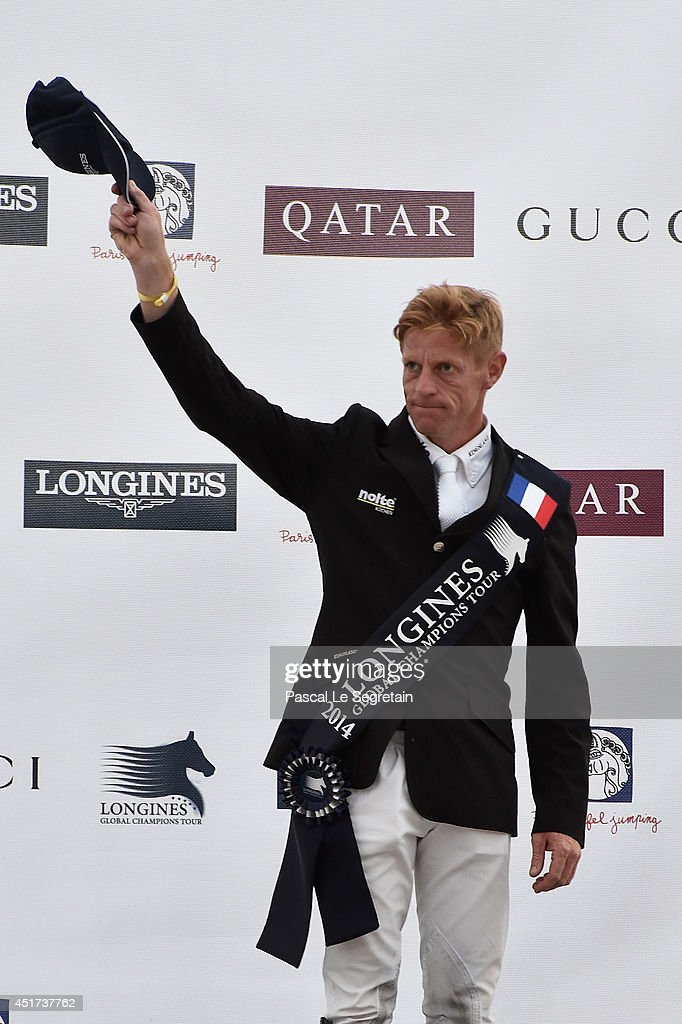 3 rank winner Winner of the 'Longines Global Champions Tour Grand Prix of Paris Competition' Marcus Ehning poses during the Paris Eiffel Jumping...