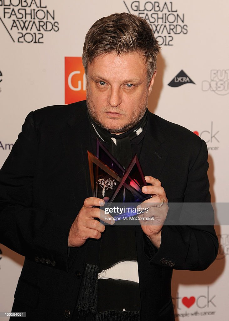 <a gi-track='captionPersonalityLinkClicked' href=/galleries/search?phrase=Rankin&family=editorial&specificpeople=146780 ng-click='$event.stopPropagation()'>Rankin</a> with his Hall of Fame award during the WGSN Global Fashion Awards at The Savoy Hotel on November 5, 2012 in London, England.