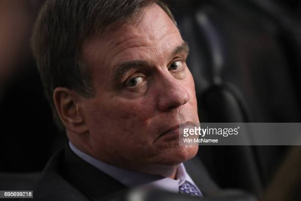 Ranking member of the committee Mark Warner listens to US Attorney General Jeff Sessions testify before the Senate Intelligence Committee on Capitol...