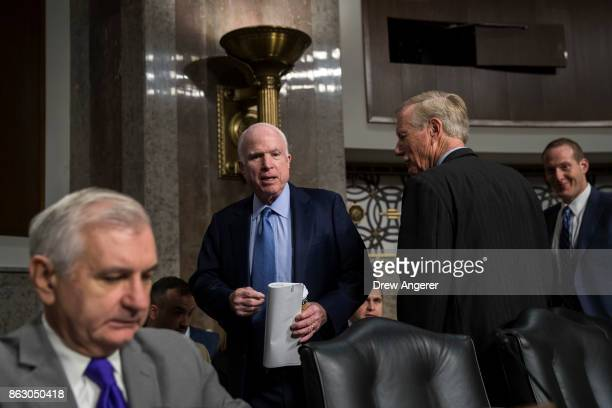Ranking member of the committee Sen Jack Reed committee chairman Sen John McCain and Sen Angus King arrive for a Senate Armed Services Committee...