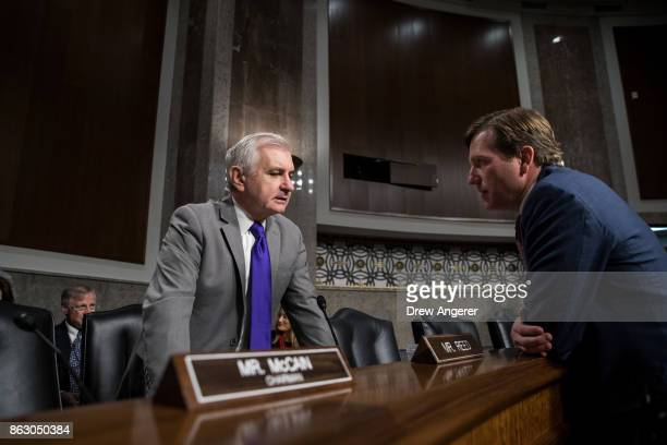 Ranking member of the committee Sen Jack Reed talks with Christopher Krebs senior official performing the duties of the under secretary for the...