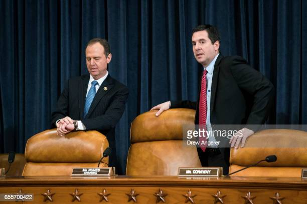 Ranking member Rep Adam Schiff and chairman Rep Devin Nunes prepare to take their seats after a break during a House Permanent Select Committee on...