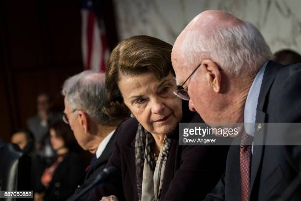 Ranking member Sen Dianne Feinstein and Sen Patrick Leahy talk with each other during a Senate Judiciary Committee hearing concerning firearm...