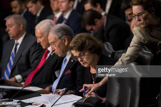 Ranking member Sen Dianne Feinstein gets a note from an aide during a Senate Judiciary Committee hearing titled 'Oversight of the Foreign Agents...