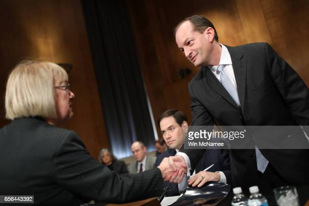 Ranking member US Sen Patty Murray greets Labor Secretary nominee Alexander Acosta before Acosta's testimony before the Senate Health Education Labor...