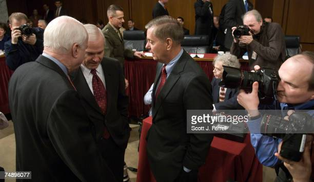 Ranking Republican John McCain RAriz Defense Secretary Robert M Gates and Sen Lindsey Graham RSC talk before the Senate Armed Services hearing on...