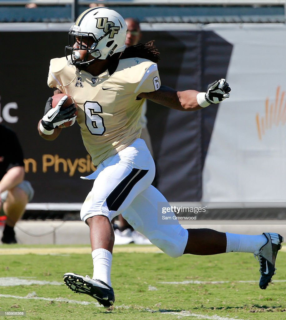 Rannell Hall #6 of the UCF Knights runs for yardage during the game against the Connecticut Huskies at Bright House Networks Stadium on October 26, 2013 in Orlando, Florida.