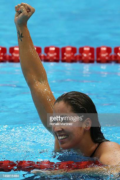 Ranomi Kromowidjojo of Netherlands celebrates winning the Women's 50m Freestyle Final on Day 8 of the London 2012 Olympic Games at the Aquatics...