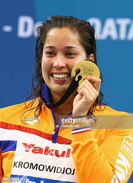 Ranomi Kromowidjojo of the Netherlands celebrates on the podium after the Women's 50m Freestyle Final during day five of the 12th FINA World Swimming...