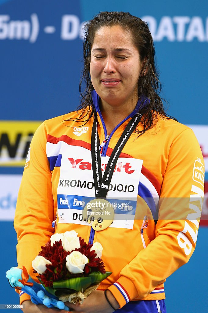 Ranomi Kromowidjojo of the Netherlands cries as she celebrates on the podium after winning the Women's 50m Freestyle Final during day five of the 12th FINA World Swimming Championships (25m) at the Hamad Aquatic Centre on December 7, 2014 in Doha, Qatar.