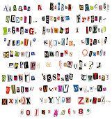 colorful alphabet of letters and numbers cut from magazines and newspapers arranged to look like a threatening letter.