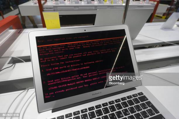 A ransomware demand for the payment of $300 worth of bitcoin sits on the screen of an Apple Inc Macbook Air laptop infected by the 'Petya' computer...