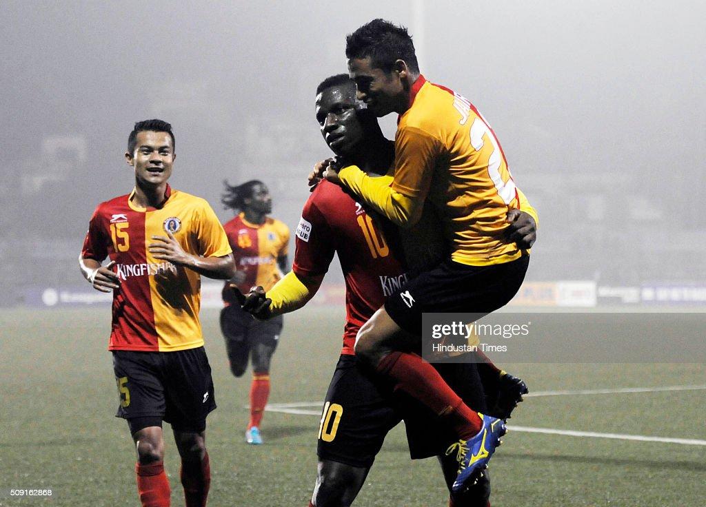 Ranti Martins of East Bengal celebrates with teammates Sanju Pradhan and Bikash Jairu after scoring the 3rd goal against Shillong Lajong FC during I League Match at Barasat Stadium on February 9, 2016 in Kolkata, India.