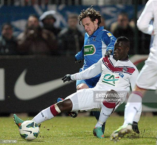 Raon l'Etape's French defender Maxime Kelsch vies with Bordeaux's Malian mildfielder Abdou Traore during the French Cup football match Raon L'Etape...