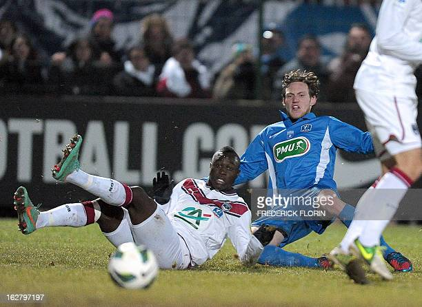 Raonl'Etape's French defender Maxime Kelsch vies with Bordeaux's Malian mildfielder Abdou Traore during their French Cup football match at the Paul...