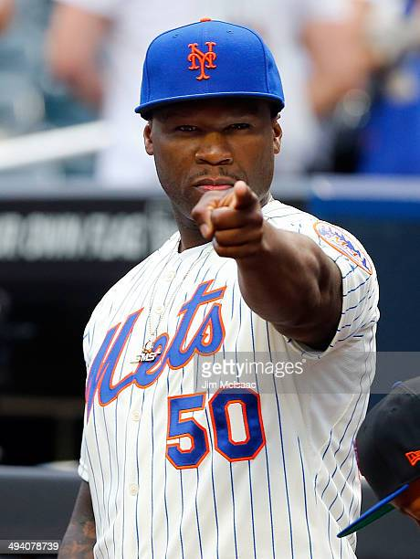 Rap artist 50 Cent looks on before throwing the ceremonial first pitch of a game between the New York Mets and the Pittsburgh Pirates at Citi Field...