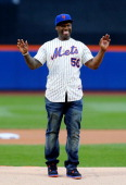 Rap artist 50 Cent reacts after throwing the ceremonial first pitch of a game between the New York Mets and the Pittsburgh Pirates at Citi Field on...