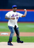 Rap artist 50 Cent throws the ceremonial first pitch before a game between the New York Mets and the Pittsburgh Pirates at Citi Field on May 27 2014...