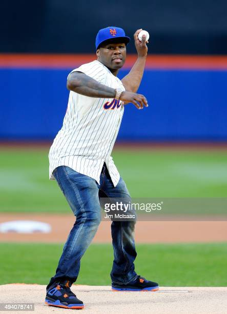 Rap artist 50 Cent throws the ceremonial first pitch of a game between the New York Mets and the Pittsburgh Pirates at Citi Field on May 27 2014 in...
