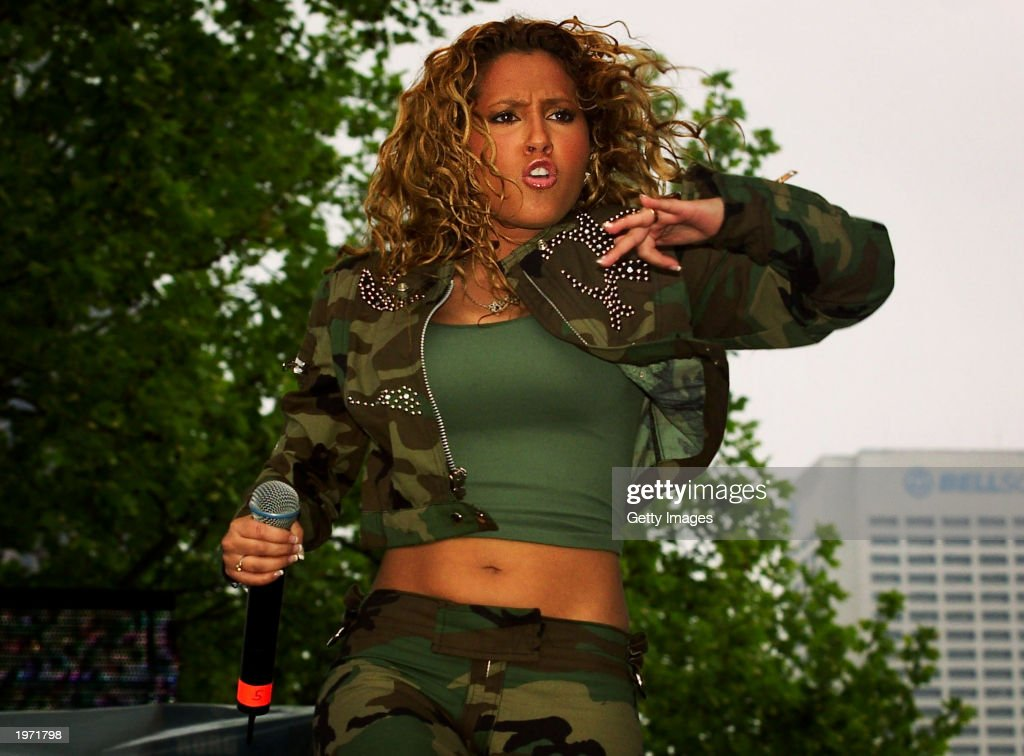 Rap artist <a gi-track='captionPersonalityLinkClicked' href=/galleries/search?phrase=Adrienne+Bailon&family=editorial&specificpeople=540286 ng-click='$event.stopPropagation()'>Adrienne Bailon</a> with 3LW performs at Music Midtown May 3, 2003 in Atlanta, Ga. Music Midtown features over 120 international, national and local musical acts performing over three days.