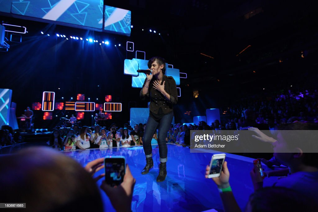 Rap artist Dessa performs during the We Day Minnesota event at the Xcel Energy Center in St. Paul, Minnesota on October 8, 2013