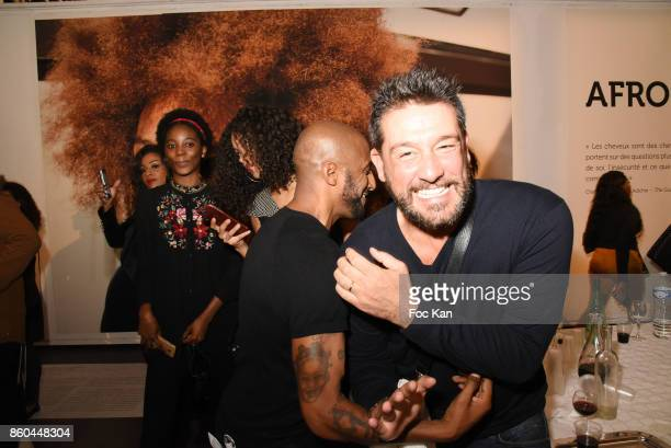 Rap artist/actor Stomy Bugsy and actor Titoff attend the 'Afro' Rokhaya Diallo and photographer Brigitte Sombie Exhibition at Maison des Metallos on...