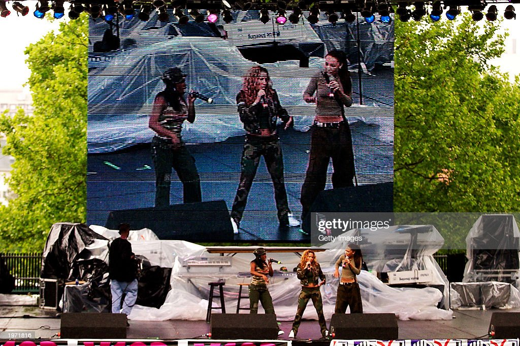 Rap artists Kiely Williams (R), Adrienne Bailon and Naturi Naughton with 3LW perform at Music Midtown May 3, 2003 in Atlanta, Ga. Music Midtown features over 120 international, national and local musical acts performing over three days.