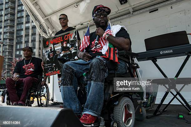 A rap group called '4 Wheel City' performs before the start of the first annual Disability Pride Parade on July 12 2015 in New York City The parade...