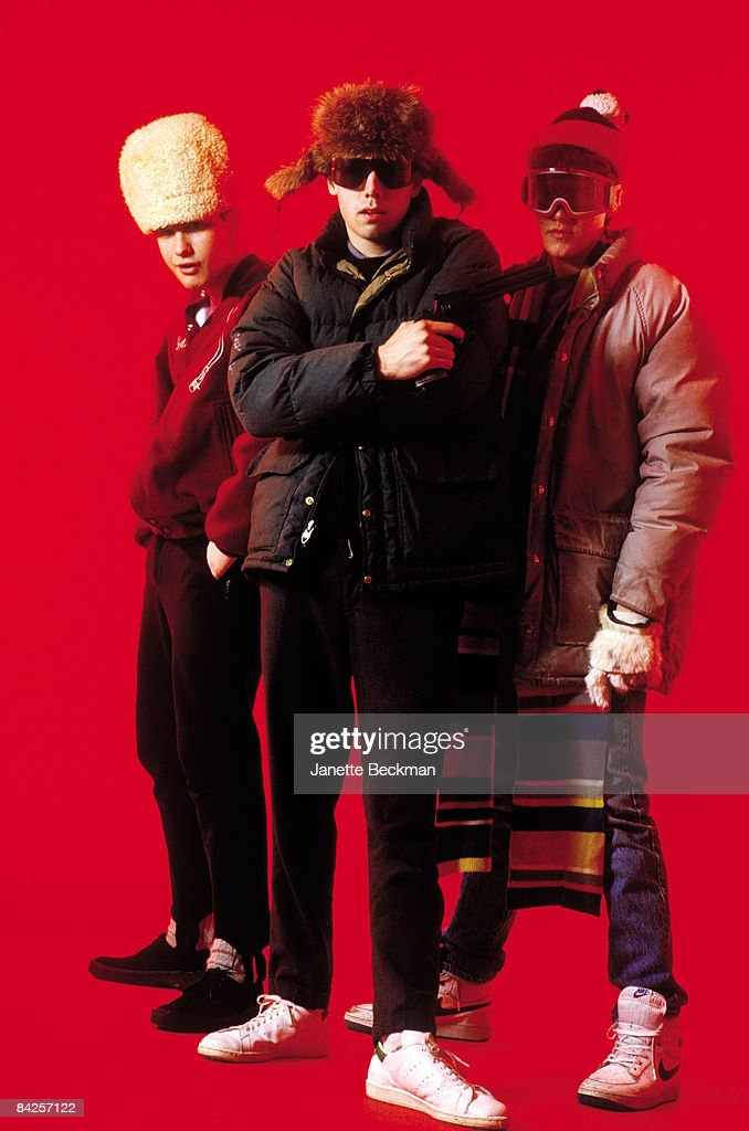 Rap group the Beastie Boys posing in funky outfits from left to right Mike Diamond Adam Yauch holding a gun and Adam Horovitz 1985 New York