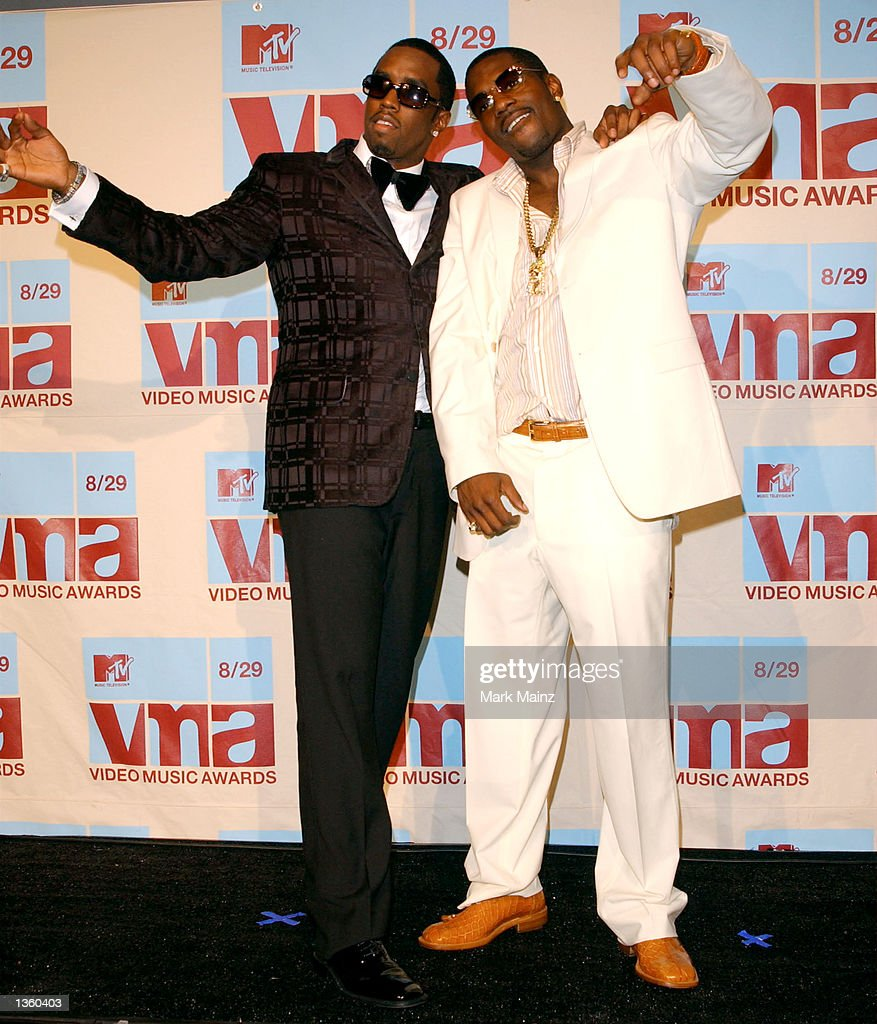 Rap mogul Sean 'P Diddy' Combs and Mace pose in the media room at the 2002 MTV Video Music Awards at Radio City Music Hall August 29 2002 in New York...