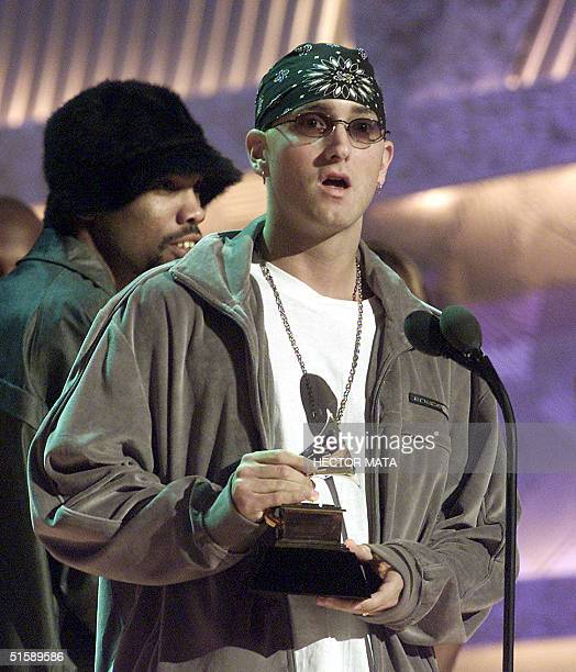Rap singer Eminem receives his trophy for the Best Rap Album Category at the 43rd Annual Grammy Awards at the Staples Center in Los Angeles 21...