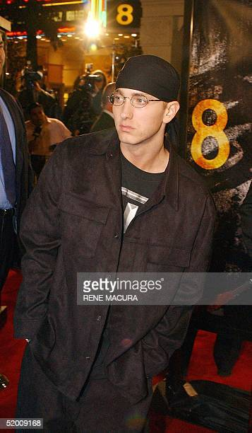 Rap singer Eminem walks past photographers at the premiere of his film '8 Mile' 06 November 2002 in the Westwood section of Los Angeles AP PHOTO/RENE...