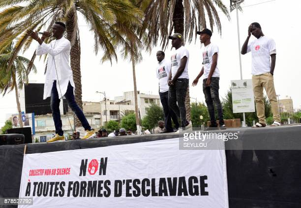Rap singers and activists from various nationalities who just visited Libya speak during a gathering against slavery on November 24 2017 on Place de...