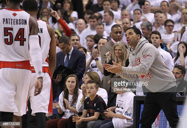 Rap star Drake cheers as the Toronto Raptors take on the Brooklyn Nets in Game Two of the NBA Eastern Conference Quarterfinals at the Air Canada...