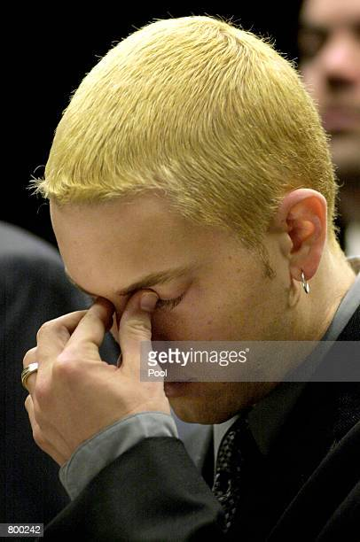 Rap star Eminem stands in Macomb County Court during his sentencing on concealed weapons charges April 10 2001 in Mount Clemens MI Mathers was given...