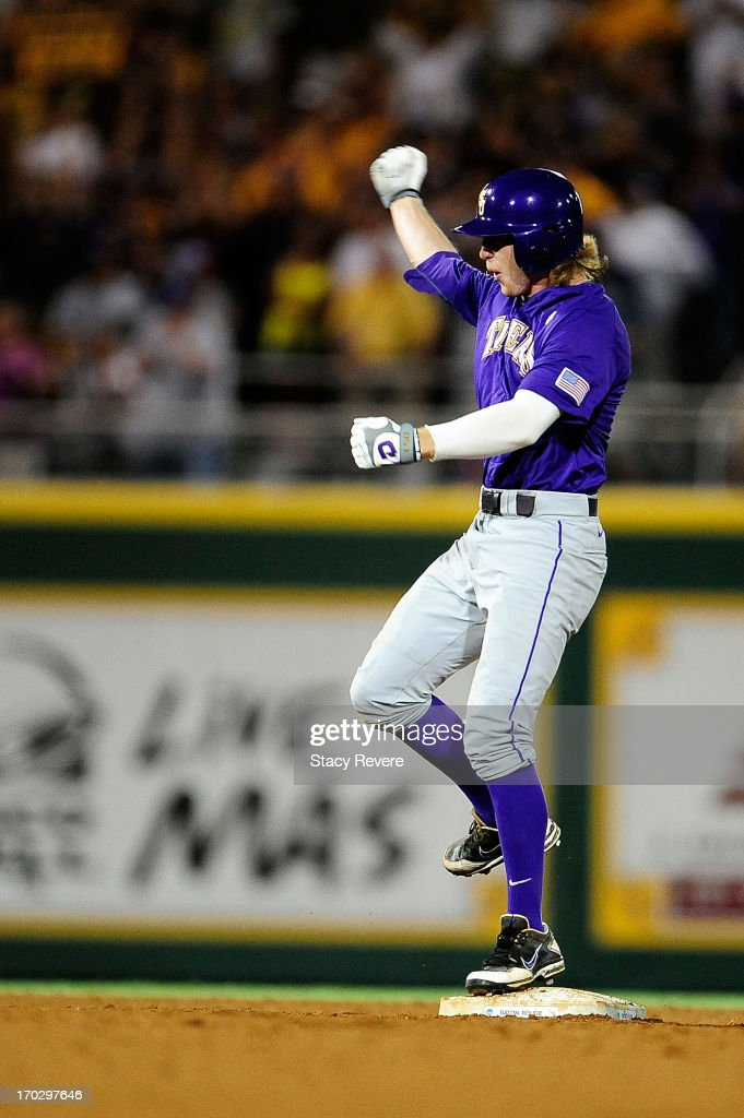 Raph Rhymes #4 of the LSU Tigers celebrates an RBI during Game 2 of the NCAA baseball Super Regionals against the Oklahoma Sooners at Alex Box Stadium on June 8, 2013 in Baton Rouge, Louisiana.