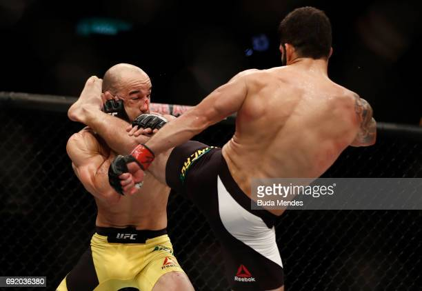 Raphael Assuncao of Brazil kicks Marlon Moraes in their bantamweight bout during the UFC 212 event at Jeunesse Arena on June 3 2017 in Rio de Janeiro...