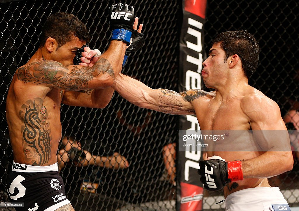Raphael Assuncao punches Vaughan Lee in their bantamweight fight during the UFC on FUEL TV event at Paulo Sarasate Arena on June 8, 2013 in Fortaleza, Ceara, Brazil.