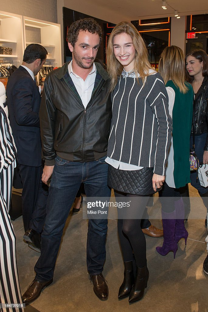 Raphael Camp and Manuela Frey attend the Joe Fresh Soho opening party at Joe Fresh Soho on October 15 2013 in New York City