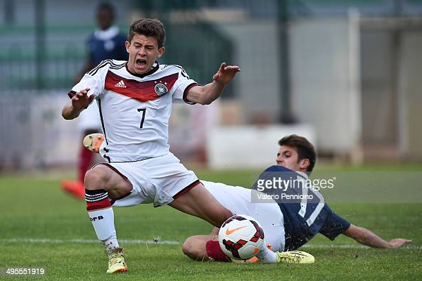 Raphael Crivello of France tackles Mats Kohlert of Germany during the International Friendly match between U16 France and U16 Germany at Stade Perruc...