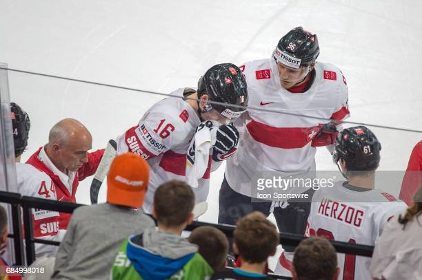 Raphael Diaz gets back to the bench after medical treatment during the Ice Hockey World Championship Quarterfinal between Switzerland and Sweden at...
