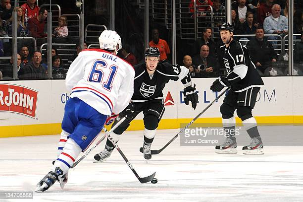 Raphael Diaz of the Montreal Canadiens handles the puck against Kyle Clifford and Ethan Moreau of the Los Angeles Kings during a game at Staples...