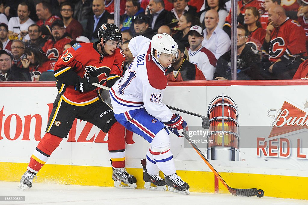 <a gi-track='captionPersonalityLinkClicked' href=/galleries/search?phrase=Raphael+Diaz&family=editorial&specificpeople=5333791 ng-click='$event.stopPropagation()'>Raphael Diaz</a> #61 of the Montreal Canadiens skates with the puck as Sean Monahan #23 of the Calgary Flames tries to check him during an NHL game at Scotiabank Saddledome on October 9, 2013 in Calgary, Alberta, Canada. The Calgary Flames defeated the Montreal Canadiens 3-2.