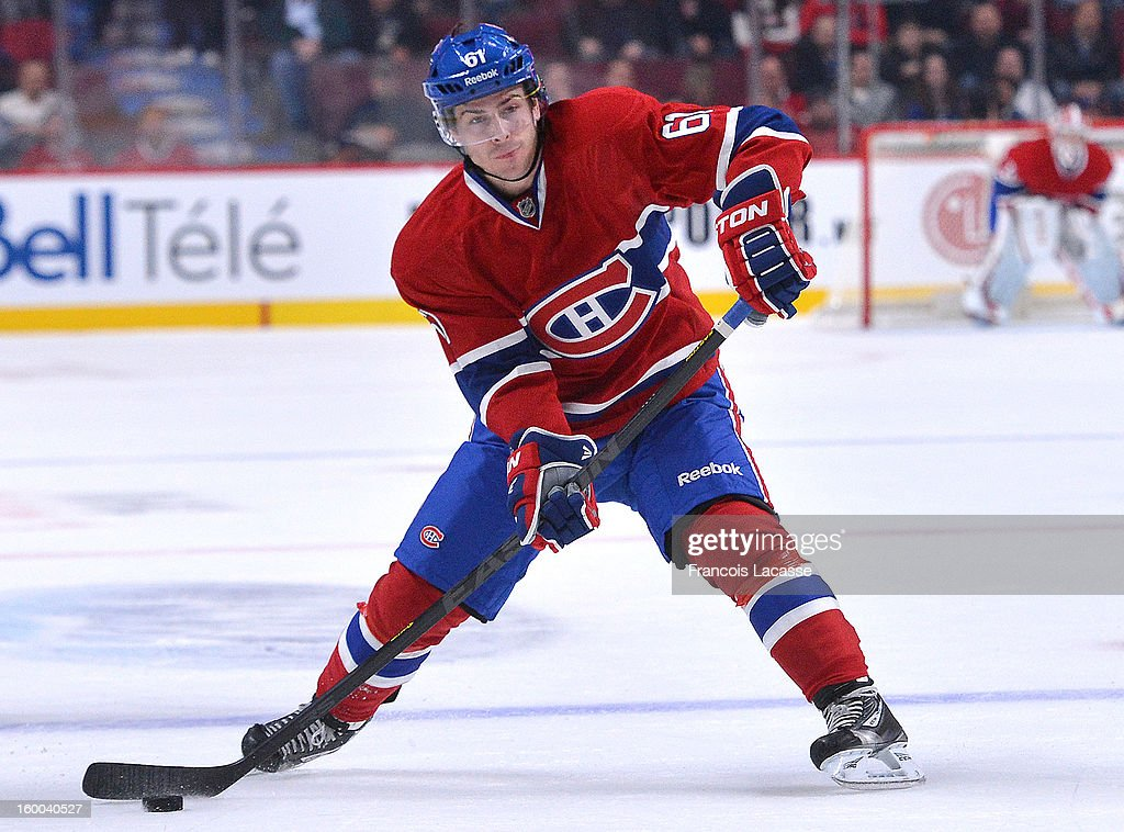 <a gi-track='captionPersonalityLinkClicked' href=/galleries/search?phrase=Raphael+Diaz&family=editorial&specificpeople=5333791 ng-click='$event.stopPropagation()'>Raphael Diaz</a> #61 of the Montreal Canadiens takes a shot in the second period against Toronto Maples Leafs during the NHL game on January 19, 2013 at the Bell Centre in Montreal, Quebec, Canada.