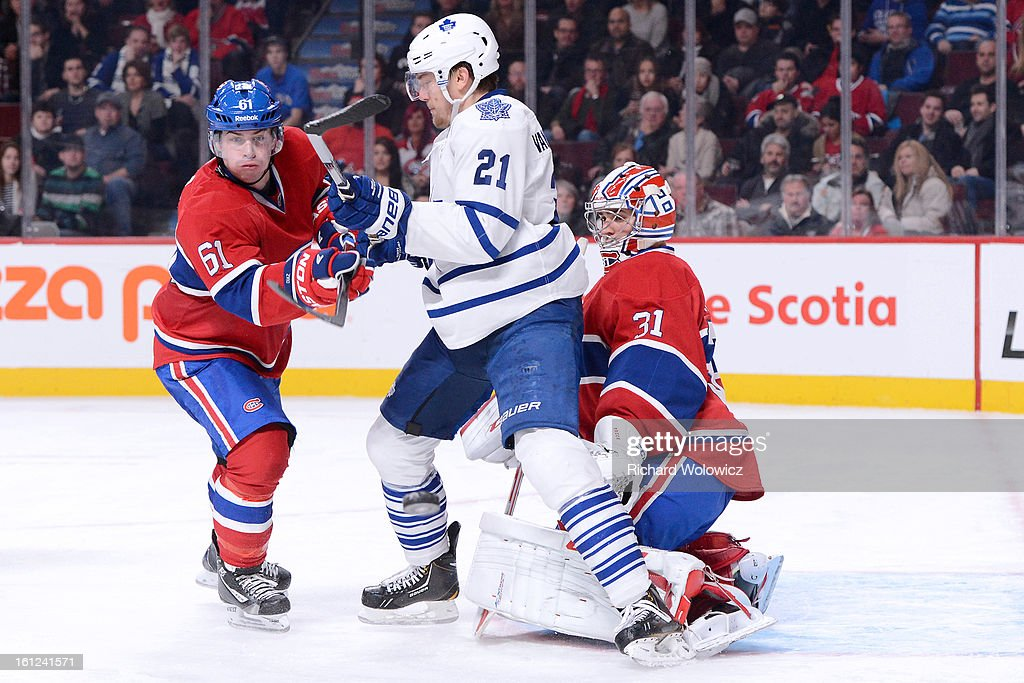 <a gi-track='captionPersonalityLinkClicked' href=/galleries/search?phrase=Raphael+Diaz&family=editorial&specificpeople=5333791 ng-click='$event.stopPropagation()'>Raphael Diaz</a> #61 of the Montreal Canadiens watches the rebounding puck in front of teammate <a gi-track='captionPersonalityLinkClicked' href=/galleries/search?phrase=Carey+Price&family=editorial&specificpeople=2222083 ng-click='$event.stopPropagation()'>Carey Price</a> #31 and James van Riemsdyk #21 of the Toronto Maple Leafs during the NHL game at the Bell Centre on February 9, 2013 in Montreal, Quebec, Canada. The Maple Leafs defeated the Canadiens 6-0.
